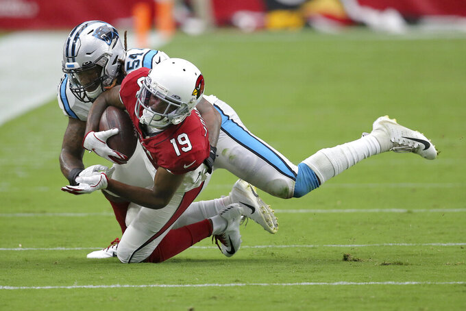 Arizona Cardinals wide receiver KeeSean Johnson (19) makes the catch as Carolina Panthers outside linebacker Shaq Thompson (54) makes the tackle during the second half of an NFL football game, Sunday, Sept. 22, 2019, in Glendale, Ariz. (AP Photo/Ross D. Franklin)