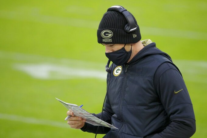 Green Bay Packers head coach Matt LaFleur looks for a play during the first half of an NFL football game against the Jacksonville Jaguars Sunday, Nov. 15, 2020, in Green Bay, Wis. (AP Photo/Mike Roemer)