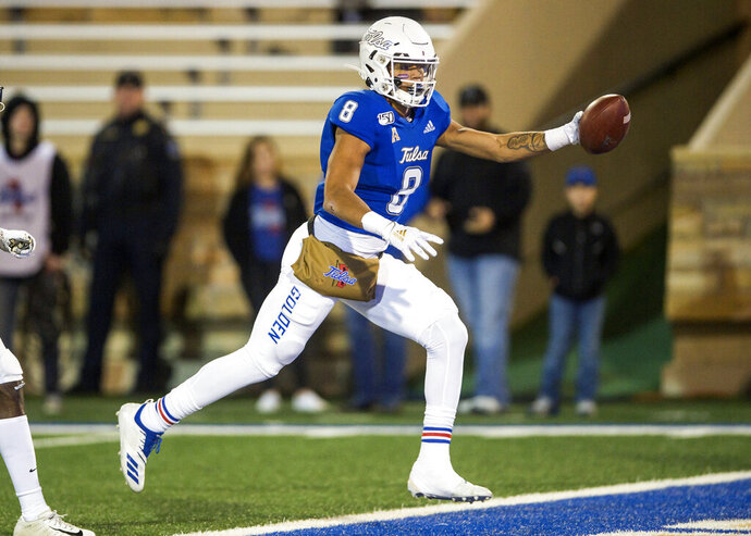 Tulsa  wide receiver Keenen Johnson runs the ball into the end zone for a touchdown during the first half of an NCAA college football game against Central Florida, Friday, Nov. 8, 2019 in Tulsa, Okla. (Brett Rojo/Tulsa World via AP)