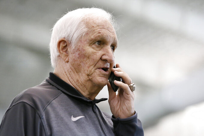 FILE - In this March 27, 2015, file photo, Gil Brandt talks on the phone as he watches players work out for scouts at TCU NFL football Pro Day in Fort Worth, Texas. Brandt will be inducted into the Pro Football Hall of Fame in Canton, Ohio on Aug. 3, 2019. (AP Photo/Tony Gutierrez, File)