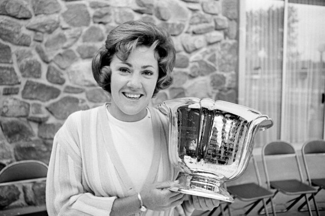 FILE - In this June 14, 1965, file photo, Susie Maxwell holds the silver trophy after winning the 36th annual Women's Western golf tournament in Chicago. Susie Maxwell Berning, one of six women to capture the U.S. Women's Open at least three times, was been elected to the World Golf Hall of Fame, Wednesday, April 22, 2020.(AP Photo/Larry Stoddard, File)