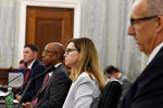 University of Baltimore law professor Dionne Koller, second from right, joined by, from left, University of Mississippi Vice Chancellor for Intercollegiate Athletics Keith Carter, National Collegiate Athletic Association Board of Governors Chairman Dr. Michael Drake and Southeastern Conference Commissioner Greg Sankey wait to testify before a Senate Commerce Committee hearing on Capitol Hill in Washington, Wednesday, July 1, 2020. The hearing is looking at the National Collegiate Athletic Association Board of Governors' recent report on student-athlete compensation and the modernization of rules related to name, image, and likeness commercialization. (AP Photo/Susan Walsh)