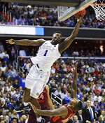 Duke forward Zion Williamson (1) drives to the basket to score on Virginia Tech's guard Ty Outlaw (42) during the second half of an NCAA men's college basketball tournament East Region semifinal in Washington, Friday, March 29, 2019. (AP Photo/Alex Brandon)