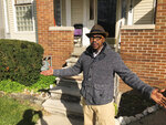 """In this Nov. 5, 2019, photo, Charles Jones Jr. stands outside his house in Detroit.  He says he will participate in the census and hopes his neighbors make sure they are counted. """"You just can't walk and knock on somebody's door, now,"""" said Jones Jr. """"You've got to find somebody in the neighborhood that the people trust. Not strangers. They're scared of strangers."""" (AP Photo/Corey Williams)"""