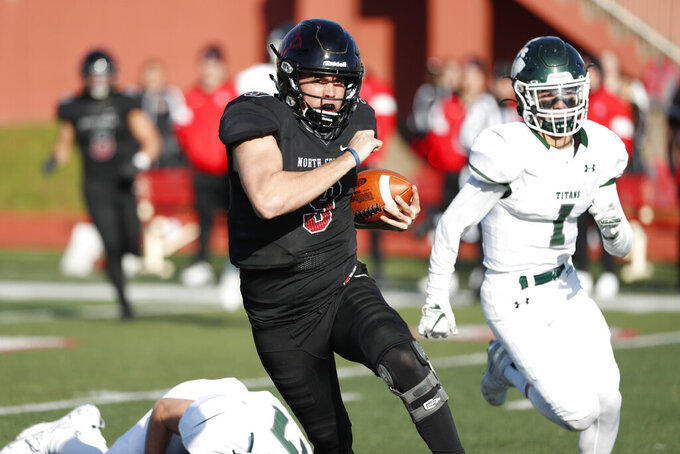 In this Nov. 9, 2019 photo, provided by North Central College Athletics, North Central quarterback Broc Rutter carries the ball against Illinois-Wesleyan during an NCAA college football game in Naperville, Ill. Rutter was selected to the Division III All-America first team on Thursday, Dec. 19, 2019.  (Steve Woltmann/North Central College Athletics via AP)