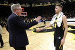 Iowa guard Jordan Bohannon, right, celebrates with coach Fran McCaffery after the team's NCAA college basketball game against Indiana, Friday, Feb. 22, 2019, in Iowa City, Iowa. Iowa won 76-70 in overtime. (AP Photo/Charlie Neibergall)