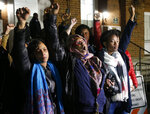 "Local activists raise their fists outside Charlottesville General District Court after a guilty verdict was reached in the trial of James Alex Fields Jr., in Charlottesville, Va., Friday, Dec. 7, 2018. Fields was convicted of first degree murder in the death of Heather Heyer as well as nine other counts during a ""Unite the Right"" rally in Charlottesville . (AP Photo/Steve Helber)"