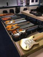 This Saturday, June 12, 2021, photo released by the Santa Cruz Police Department shows some of the nine vintage guitars that were stolen nearly a year ago in a $2 million heist in Southern California, displayed in Santa Cruz, Calif. The San Francisco Chronicle reported late Saturday that Santa Cruz police found the guitars after serving search warrants at three different locations in the city following a tip from Los Angeles police. The instruments are worth a combined $225,0000. They were part of some $2 million in music equipment stolen from a Los Angeles County storage unit in July. (Santa Cruz Police Department via AP