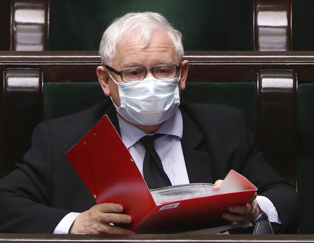 Poland's main ruling party leader Jaroslaw Kaczynski, wears an anti-coronavirus mask in parliament during work on new legislation that is to ensure the health and safety of the postponed presidential election to be held this summer, in Warsaw, Poland, Tuesday, May 12, 2020. (AP Photo/Czarek Sokolowski)