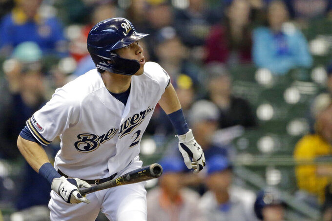 Milwaukee Brewers' Christian Yelich watches the ball after hitting a solo home run during the first inning of a baseball game against the Washington Nationals Wednesday, May 8, 2019, in Milwaukee. (AP Photo/Aaron Gash)
