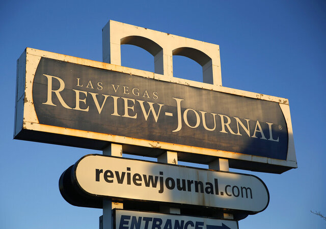 FILE - This Dec. 17, 2015 file photo shows a sign outside the building housing the Las Vegas Review-Journal in Las Vegas. A Nevada judge says the Las Vegas Review-Journal owes $1.9 million and counting to its crosstown rival Las Vegas Sun in an ongoing legal battle over profit sharing under their joint-operating agreement. (AP Photo/John Locher, File)