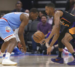 Phoenix Suns forward Mikal Bridges, right, steals the ball from Sacramento Kings forward Harrison Barnes during the first half of an NBA basketball game Sunday, Feb. 10, 2019, in Sacramento, Calif. (AP Photo/Rich Pedroncelli)