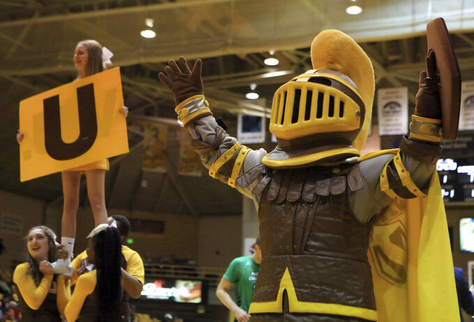 The Valparaiso Crusaders mascot helps the cheer squad during a timeout in an NCAA college basketball game against North Dakota on Nov. 17, 2019, in Valparaiso, Ind. Valparaiso University will begin searching for a new team name after dropping Crusaders, the school mascot and all logos associated with the name because school officials said hate groups have embraced the term, the school announced Thursday, Feb. 11, 2021. (Kale Wilk/The Times via AP)