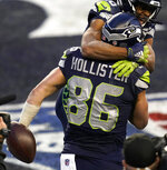 Seattle Seahawks tight end Jacob Hollister (86) celebrates with wide receiver Tyler Lockett, top, during the second half of an NFL football game against the Los Angeles Rams, Sunday, Dec. 27, 2020, in Seattle. The Seahawks won 20-9. (AP Photo/Elaine Thompson)