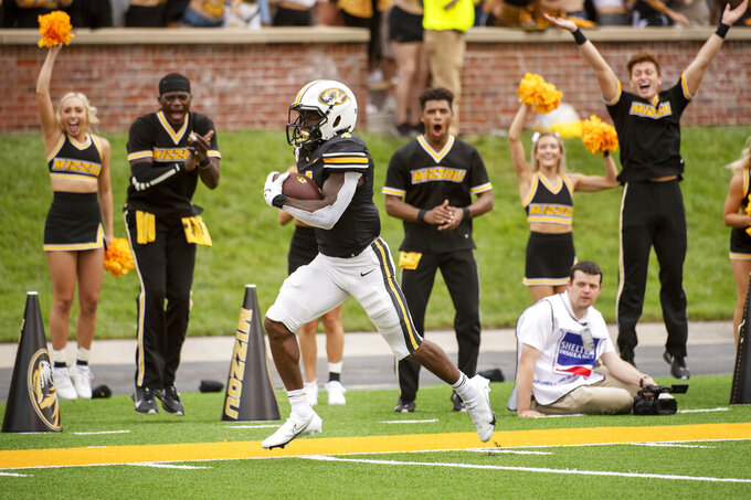 Missouri running back Elijah Young runs along the sideline for a touchdown during the third quarter of an NCAA college football game against Central Michigan, Saturday, Sept. 4, 2021, in Columbia, Mo. (AP Photo/L.G. Patterson)
