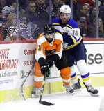 Philadelphia Flyers' Radko Gudas (3) tries to keep the puck away from St. Louis Blues' Zach Sanford (12) during the first period of an NHL hockey game, Monday, Jan. 7, 2019, in Philadelphia. (AP Photo/Matt Slocum)