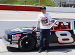 Dale Earnhardt Jr. stands by the car he will drive in pre-race activities before the NASCAR Xfinity Series auto race at Darlington Raceway, Saturday, May 8, 2021, in Darlington, S.C. The car is a Chevy Nova that his father drove in what is now the Xfinity Series. (AP Photo/Terry Renna)