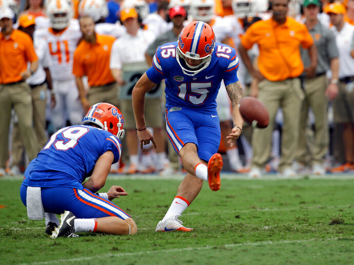 FILE - In this Sept. 16, 2017, file photo, Florida place kicker Eddy Pineiro (15) kicks a 27-yard field goal against Tennessee during the first half of an NCAA college football game, in Gainesville, Fla. Florida kicker Eddy Pineiro and punter Johnny Townsend are looking to become the first specialists drafted from the same team in the same year since 1985. (AP Photo/John Raoux, File)