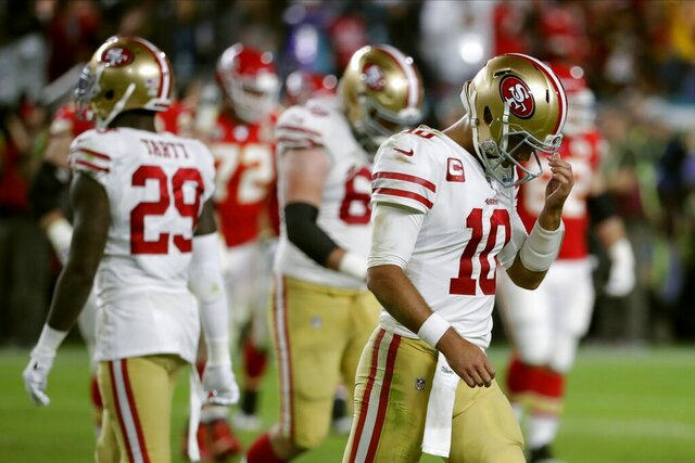 San Francisco 49ers quarterback Jimmy Garoppolo walks to the sideline during the second half of the NFL Super Bowl 54 football game against the Kansas City Chiefs Sunday, Feb. 2, 2020, in Miami Gardens, Fla. (AP Photo/Matt York)