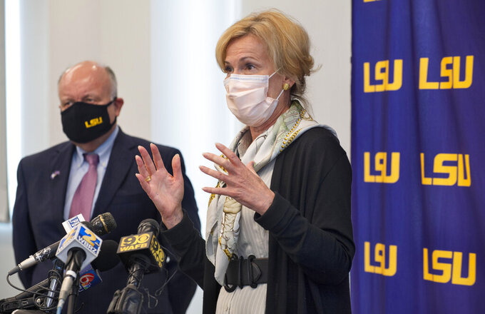 Dr. Deborah Birx, right, coordinator of the White House coronavirus task force, speaks at a press conference along LSU interim President Tom Galligan, left, after one of several roundtable discussions with LSU officials and others, Wednesday, Sept. 23, 2020 in the LSU Foundation Training Room in Baton Rouge, La.   (Travis Spradling/The Advocate via AP)