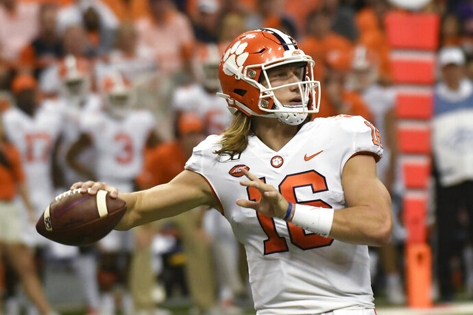 Clemson quarterback Trevor Lawrence throws a touchdown pass against Syracuse during the first half of an NCAA college football game Saturday, Sept. 14, 2019, in Syracuse, N.Y. (AP Photo/Steve Jacobs)