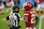 Down judge Sarah Thomas (53) talks with Kansas City Chiefs cornerback Bashaud Breeland, right, before the NFL Super Bowl 55 football game between the Chiefs and Tampa Bay Buccaneers, Sunday, Feb. 7, 2021, in Tampa, Fla. (AP Photo/Lynne Sladky)