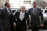 Harvey Weinstein, center, arrives at a Manhattan courthouse for his trial on rape and sexual assault charges, Thursday, Jan. 23, 2020, in New York. (AP Photo/Mark Lennihan)