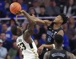 Duke's Cam Reddish (2) blocks a shot by Wake Forest's Chaundee Brown (23) during the second half of an NCAA college basketball game in Winston-Salem, N.C., Tuesday, Jan. 8, 2019. (AP Photo/Chuck Burton)