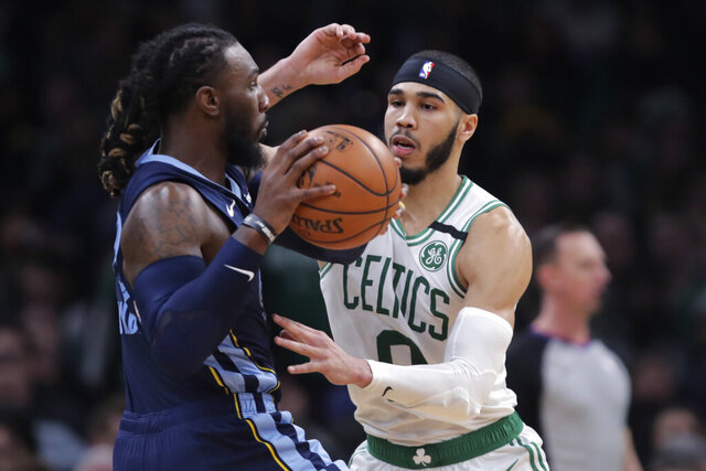 Boston Celtics forward Jayson Tatum (0) pressures Memphis Grizzlies forward Jae Crowder, left, during the second half of an NBA basketball game in Boston, Wednesday, Jan. 22, 2020. (AP Photo/Charles Krupa)