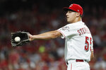 Cincinnati Reds relief pitcher Robert Stephenson gets the ball after giving up an RBI single to St. Louis Cardinals' Paul DeJong during the sixth inning of a baseball game Thursday, July 18, 2019, in Cincinnati. (AP Photo/John Minchillo)