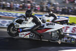 In this photo provided by the NHRA, Steve Johnson, foreground, drives in Pro Stock Motorcycle qualifying Friday, Oct. 8, 2021, at the Texas NHRA FallNationals drag races at Texas Motorplex in Ennis, Texas. (NHRA via AP)