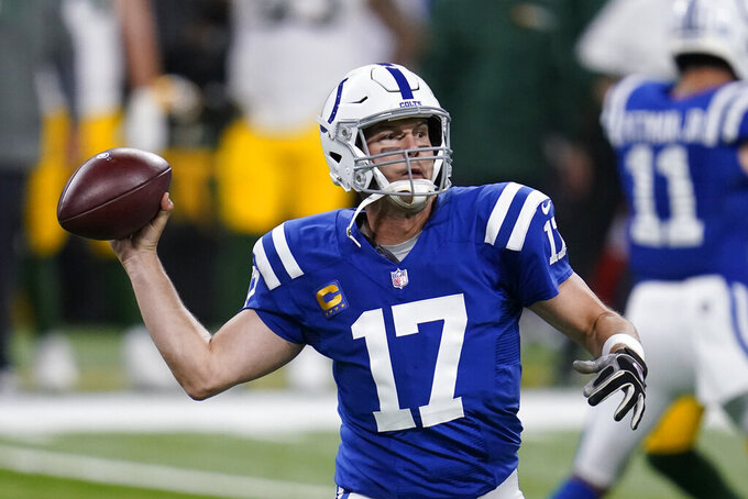 Indianapolis Colts quarterback Philip Rivers (17) looks to throw during the first half of an NFL football game against the Green Bay Packers, Sunday, Nov. 22, 2020, in Indianapolis. (AP Photo/Michael Conroy)