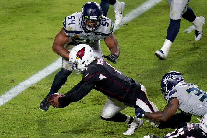 Arizona Cardinals quarterback Kyler Murray (1) dives in for a touchdown as Seattle Seahawks middle linebacker Bobby Wagner (54) defends during the second half of an NFL football game, Sunday, Oct. 25, 2020, in Glendale, Ariz. (AP Photo/Ross D. Franklin)