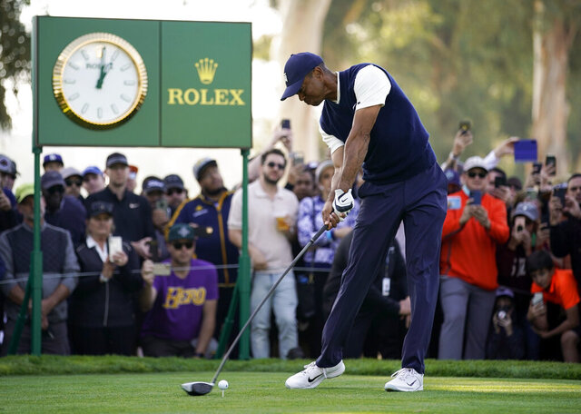 Tiger Woods tees off on the ninth hole during the third round of the Genesis Invitational golf tournament at Riviera Country Club, Saturday, Feb. 15, 2020, in the Pacific Palisades area of Los Angeles. (AP Photo/Ryan Kang)