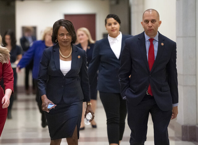 Rep. Val Demings, D-Fla., left, and Rep. Hakeem Jeffries, D-N.Y., two of House Speaker Nancy Pelosi's impeachment managers, walk to a news conference before Pelosi sends articles of impeachment to the Senate charging President Donald Trump with abuse of power and obstruction of Congress, at the Capitol in Washington, Wednesday, Jan. 15, 2020. (AP Photo/J. Scott Applewhite)