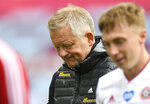 Sheffield United's manager Chris Wilder leaves the pitch at the end of the English Premier League soccer match between Burnley and Sheffield United, at Turf Moor Stadium in Burnley, England, Sunday, July 5, 2020. The match ended 1-1. (Peter Powell/Pool Photo via AP)