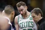 Boston Celtics forward Gordon Hayward (20) is taken off the court after being injured during the second half of an NBA basketball game against the Indiana Pacers in Indianapolis, Wednesday, Dec. 11, 2019. The Pacers defeated the Celtics 122-117. (AP Photo/Michael Conroy)