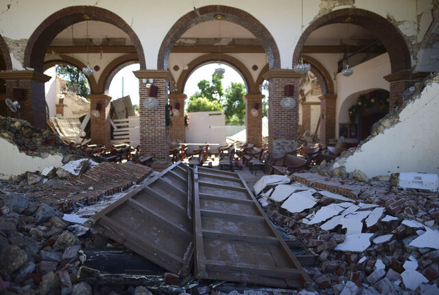 The Immaculate Concepcion Catholic church lies in ruins after an overnight earthquake in Guayanilla, Puerto Rico, Tuesday, Jan. 7, 2020. A 6.4-magnitude earthquake struck Puerto Rico before dawn on Tuesday, killing one man, injuring others and collapsing buildings in the southern part of the island. (AP Photo/Carlos Giusti)