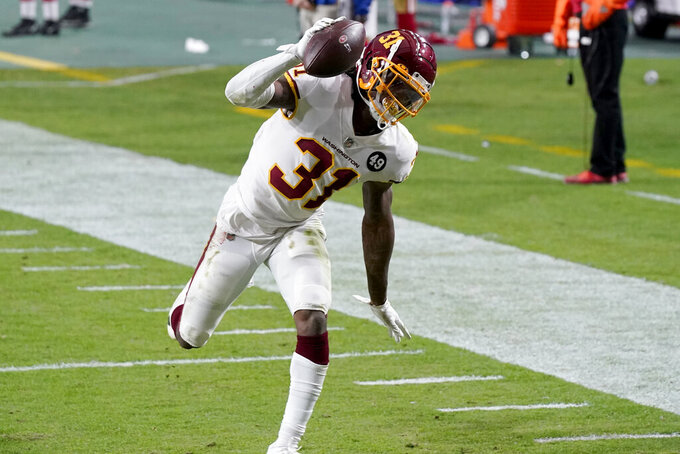 Washington Football Team strong safety Kamren Curl (31) runs back an interception for a touchdown against the San Francisco 49ers during the second half of an NFL football game, Sunday, Dec. 13, 2020, in Glendale, Ariz. (AP Photo/Ross D. Franklin)
