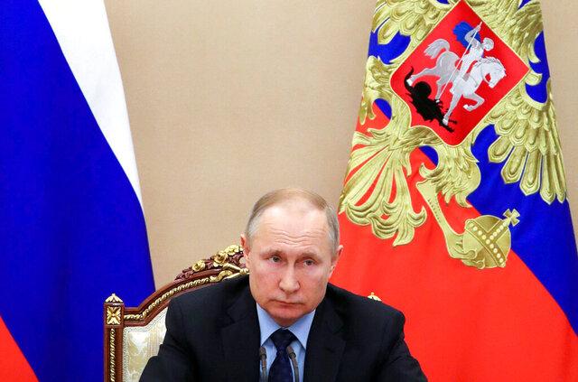 Russian President Vladimir Putin leads a cabinet meeting in the Kremlin in Moscow, Russia, Tuesday, March 17, 2020. (Mikhail Klimentyev, Sputnik, Kremlin Pool Photo via AP)
