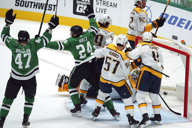 Dallas Stars right wing Alexander Radulov (47) and Dallas Stars left wing Roope Hintz (24) celebrate a second period goal against the Nashville Predators during an NHL hockey game, Sunday, Jan. 24, 2021 in Dallas. (AP Photo/Richard W. Rodriguez)