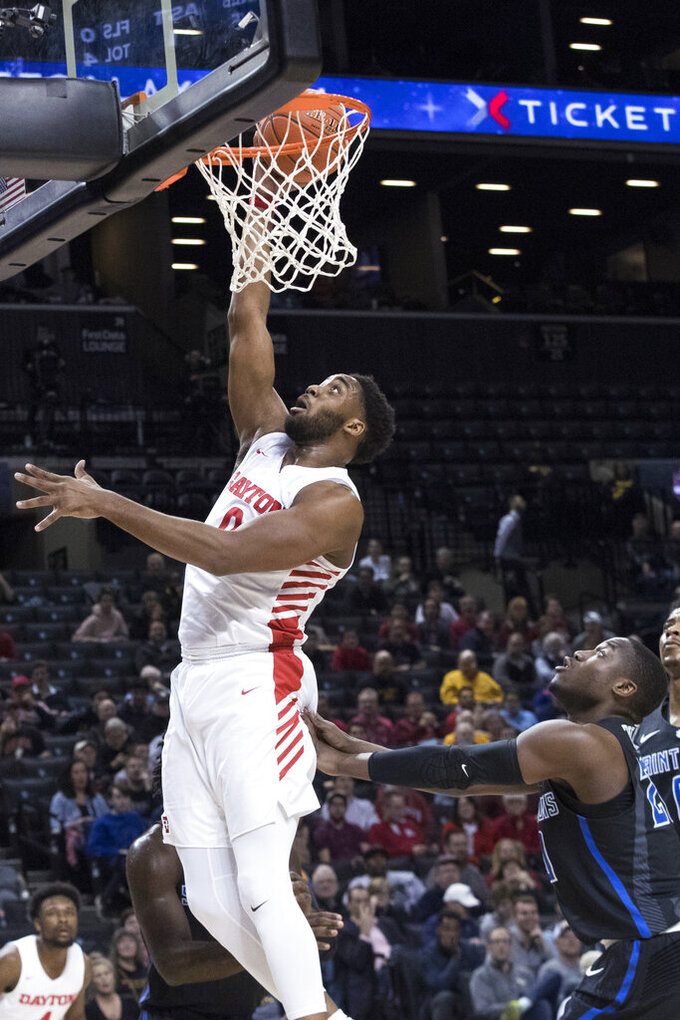 Dayton forward Josh Cunningham goes to the basket during the first half of the team's NCAA college basketball game in the Atlantic 10 Conference tournament against Saint Louis, Friday, March 15, 2019, in New York. (AP Photo/Mary Altaffer)