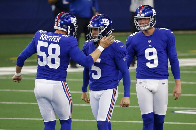 New York Giants' Casey Kreiter (58), place kicker Graham Gano (5) and punter Riley Dixon (9) celebrate a field goal kicked by Gano in the first half of an NFL football game against the Dallas Cowboys in Arlington, Texas, Sunday, Oct. 11, 2020. (AP Photo/Ron Jenkins)