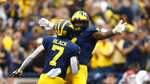 Michigan wide receiver Nico Collins (4) celebrates his 48-yard touchdown reception with Tarik Black (7) in the first half of an NCAA college football game against Rutgers in Ann Arbor, Mich., Saturday, Sept. 28, 2019. (AP Photo/Paul Sancya)