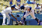 Los Angeles Dodgers' Mookie Betts, right, is congratulated by third base coach Dino Ebel as he rounds third after hitting a solo home run during the third inning of a baseball game against the Texas Rangers Sunday, June 13, 2021, in Los Angeles. (AP Photo/Mark J. Terrill)