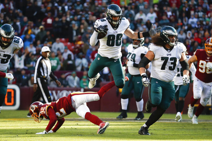 Philadelphia Eagles tight end Dallas Goedert (88) leaps over Washington Redskins cornerback Jimmy Moreland (32) to avoid being tackled as he runs downfield in the first half of an NFL football game, Sunday, Dec. 15, 2019, in Landover, Md. (AP Photo/Alex Brandon)