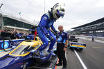 Jimmie Johnson get out of his car following practice for the IndyCar auto race at Indianapolis Motor Speedway, Friday, Aug. 13, 2021, in Indianapolis. (AP Photo/Darron Cummings)