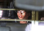 FILE - In this Aug. 17, 2017, file photo, Hong Kong activist Joshua Wong is taken away in a prison bus leaving the high court after his sentencing in Hong Kong, Overseas, Joshua Wong has emerged as a prominent face of Hong Kong's months-long protests for full democracy. At home, he is just another protester. (AP Photo, File)