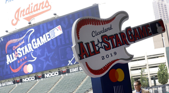 "FILE - The new logo for the 2019 All-Star Game is displayed, Tuesday, Aug. 7, 2018, in Cleveland. The Indians are reviewing their contentious nickname. The team released a statement on Friday, July 3, 2020 saying it is committed to ""making a positive impact in our community and embrace our responsibility to advance social justice and equality."" The club said it plans to review a nickname it has had since 1905.(AP Photo/Tony Dejak, file)"
