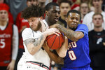 SMU's Jahmal McMurray, right, and Cincinnati's Logan Johnson wrestle for the ball during the first half of an NCAA college basketball game Saturday, Feb. 2, 2019, in Cincinnati. (AP Photo/John Minchillo)